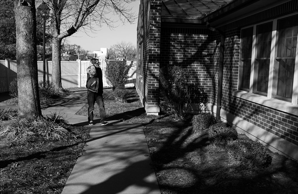 November 2017:  Clarence walks the fenced-in area at Sunset Nursing Home in Quincy. A psychiatrist at Blessing Hospital says Clarence's disorientation (dementia symptoms) could easily be a temporary result of dehydration. However, Brenda and Ben have health problems of their own, making it difficult to take care of Clarence, so they ask about admitting Clarence into a nursing home. In his current state of confusion, Clarence believes people and institutions are trying to kill him. He's constantly anxious. Because he was imagining people were trying to kill him, he stopped eating at home. Clarence went from 125 pounds in July, when Vickie died, to 97 pounds by November, only four months later. After nearly being placed into a nursing home far from Quincy by Blessing Hospital staff, against the family's wishes, Clarence ultimately was admitted to Sunset Nursing Home in Quincy.