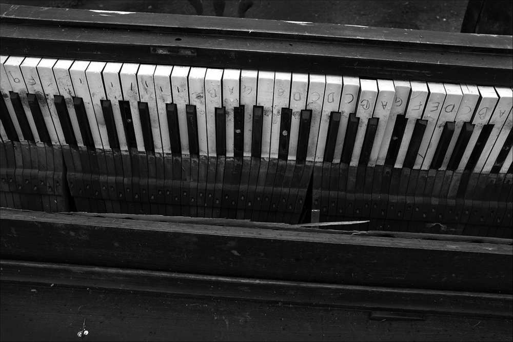 """May 2017:  The marks Elizabeth placed on her piano keys years ago when she began taking lessons are still visible after her treasured """"friend"""" was left to ruin in the rain."""
