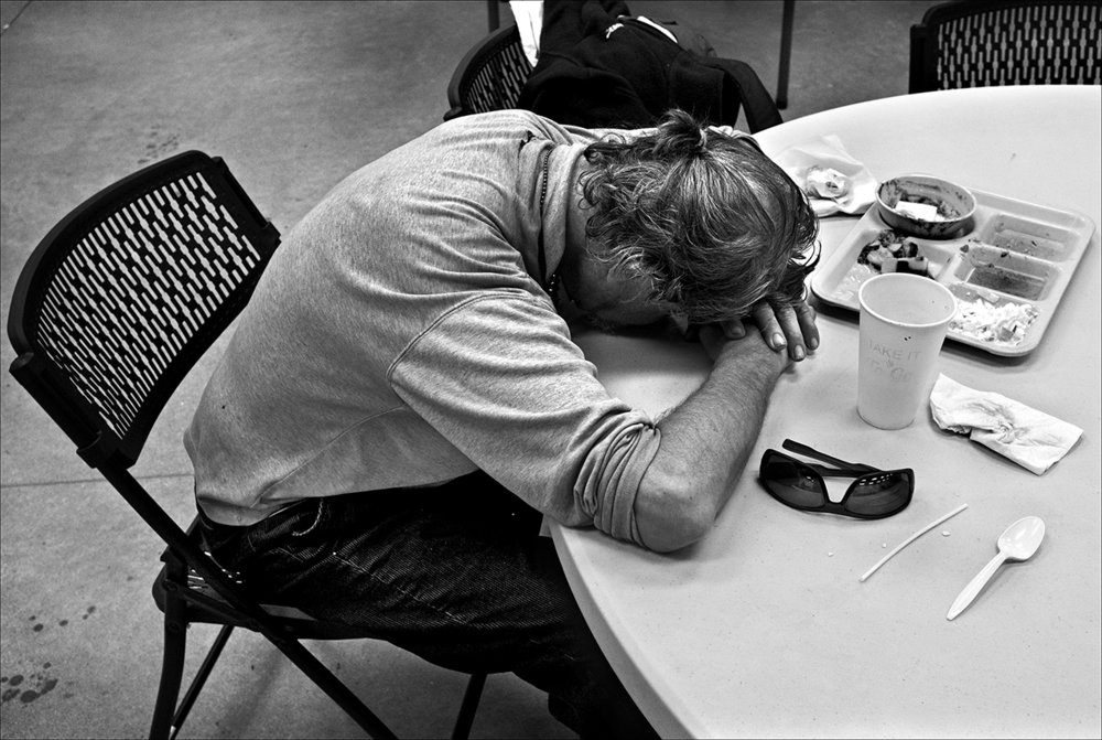 "April 2017:  After a sleepless night, James rests his head on a table at the Horizons Soup Kitchen.  ""You have to accept the fact, damn.  The more you resist knowing the fact that you're homeless, the worse it can be for you mentally and emotionally."""