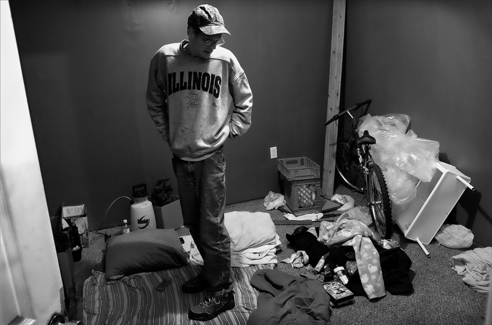 """January 2017:  James stands in the center off his room in an apartment he now subleases with friends. After nearly a year of being homeless, James seems to have found a place that may work out for him. """"I've come a long way from my little spot in the woods,"""" James said."""