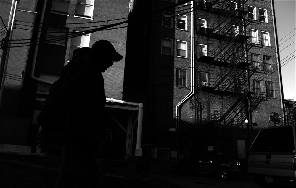 """November 2016:  On a cold November morning, James makes his way to Catholic Charities for a cup of hot coffee. A week earlier James said he was attacked and struck in the face. Hiding for three days to recover, James missed his opportunity for a free meal Thursday and Friday at the Horizons Soup Kitchen and the Saturday meal at Salem Church. """"I haven't had anything to eat since Thursday,"""" he said."""