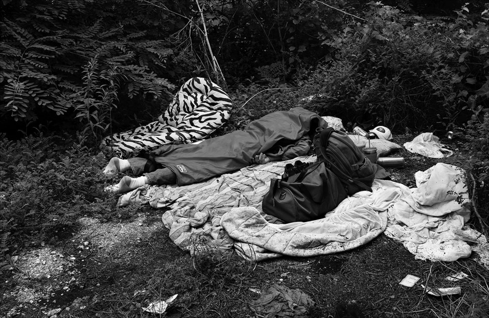 June 2016:  James sleeps outside in a small brushy area within The District where he fends off mosquitoes and unexpected rain showers. James says he recently got caught in a storm and tried to cover up with his sleeping bag but got soaked. He has been trying to live off his $373 a month in food and cash assistance since April, 2016, when he became homeless after he says his mom remarried and moved to another state without him.