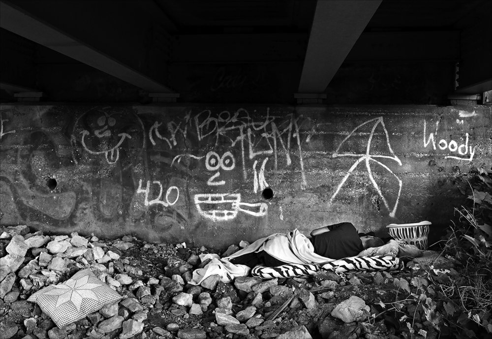 August 2017:  Escaping the rain, James has moved his meager belongings to an area under a local bridge where he will remain dry.