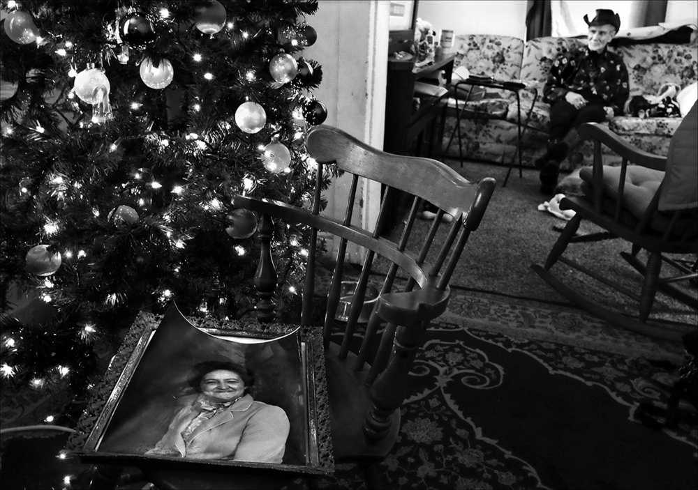December 2016:  A photograph of Sandy sits on a chair in front of the Christmas tree where she and Walter called home.