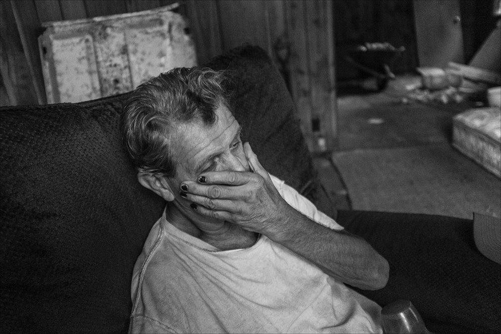 SEPTEMBER 2018:  James rests in a chair where he is living in an abandoned house in Quincy. He is undecided as to whether or not to move to a warmer year round climate before winter.