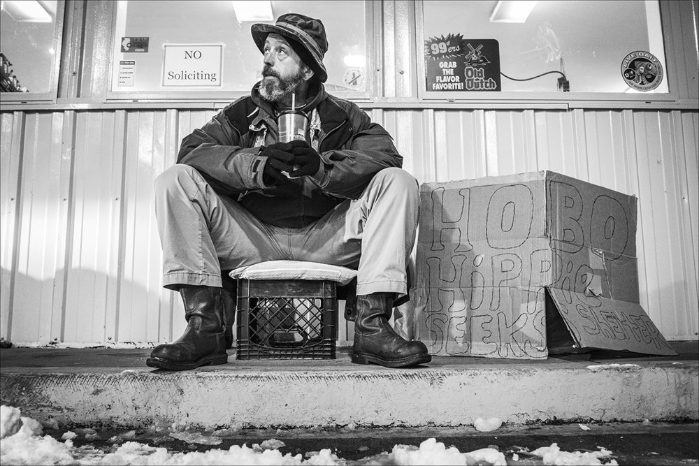 "January 2019:  Tom, homeless, sits outside of a local gas station in Quincy, Sunday evening, Jan., 13, 2109. He said, after being asked to leave a Quincy emergency shelter for quarreling with a roommate, he sought refuge at another shelter in town. Tom said, after being allowed to stay on a couch there one night, the board of directors decided he couldn't stay there because of ""liability concerns"" related to the seizures he suffers."