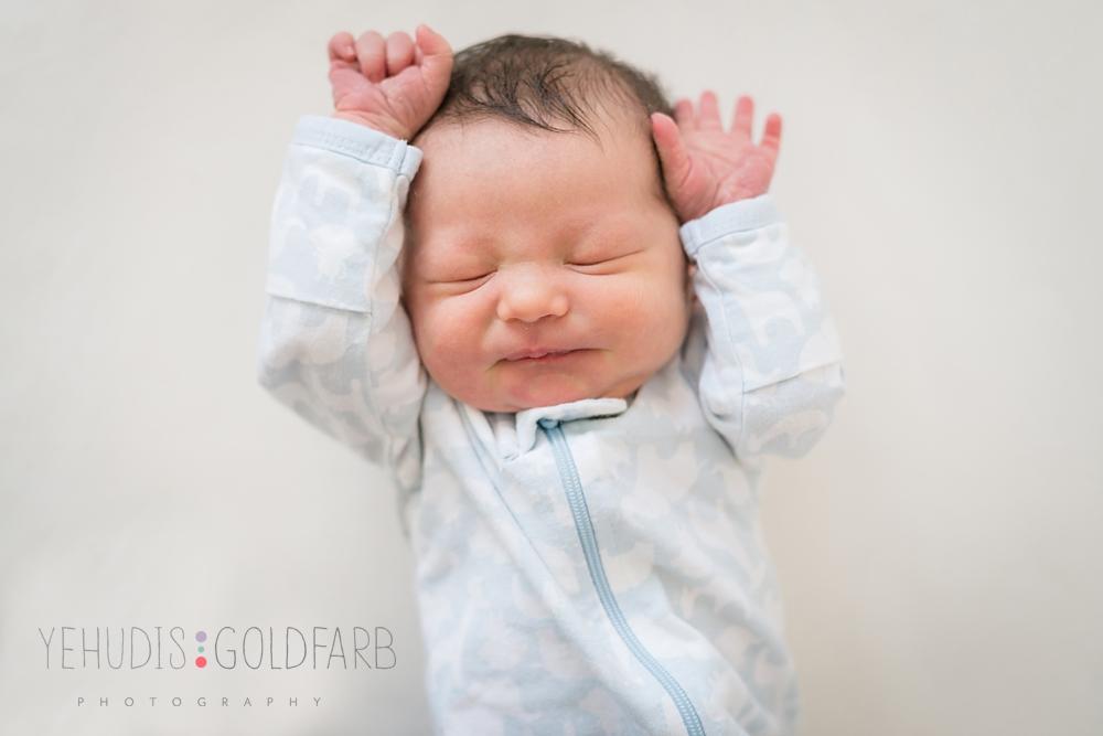6_newborn-baby-boy-portrait-hands-by-head.jpg