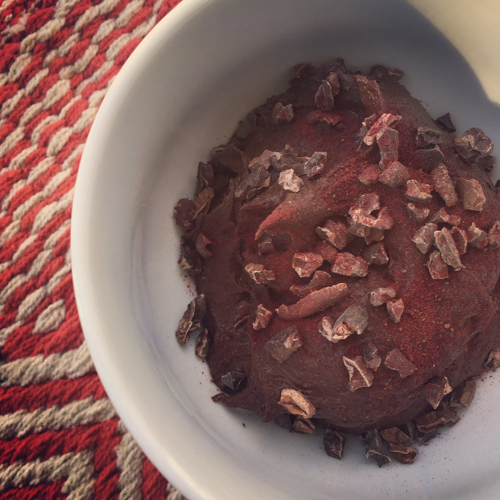 Nutrition Atlanta Brownie batter hummus topped with organic beet powder and raw cacao nibs