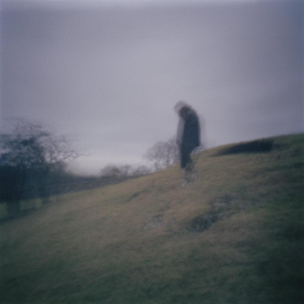 girl running down a hill.jpg