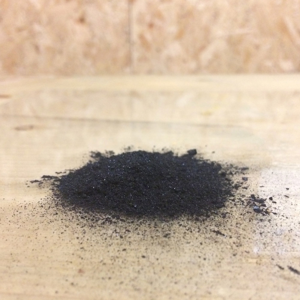 Black ash from the Spit and Sawdust fire pit. This was ground up and made into an egg tempera paint which I used to create the final  wall mural .