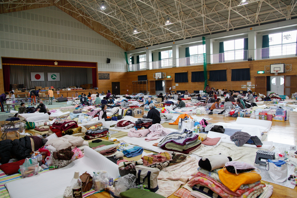People at an evacuation center - (c) amata90 / Shutterstock.com