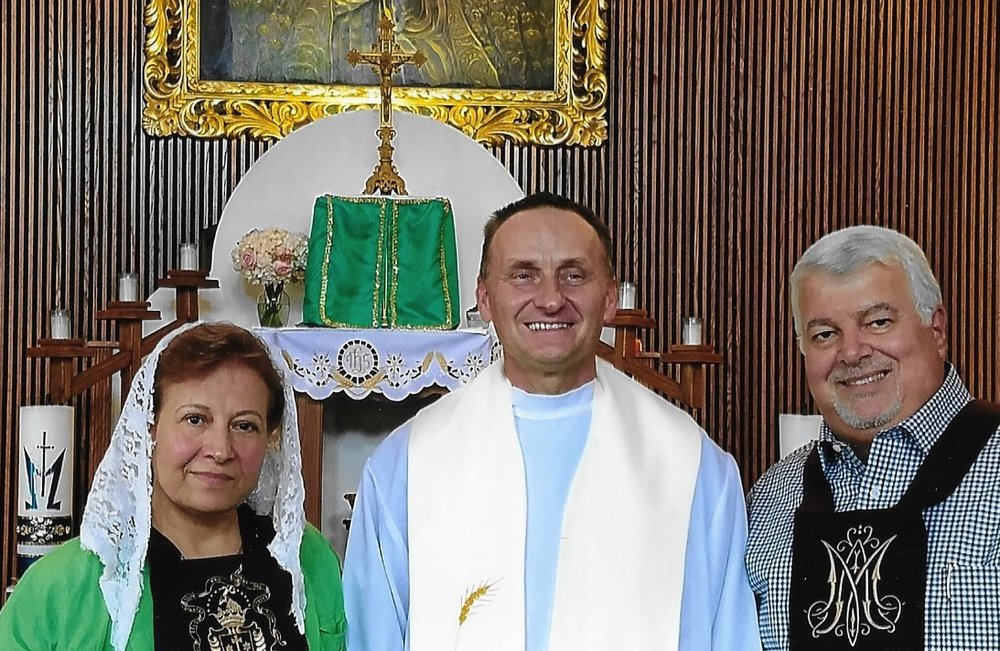 Mary, Fr. Frederick, and Ghanem upon the reception of their official, solemn Scapulars