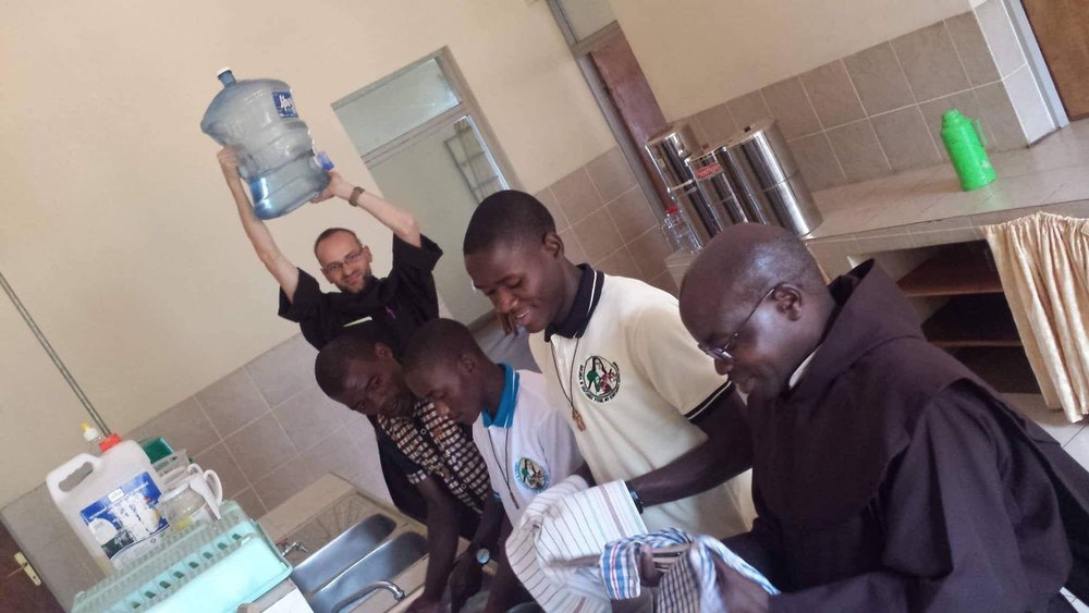 Fr. Paul, OCD shows water obtained from a new well at the Carmelite Mission in Rwanda, supported by benefactors from all over the world, including the Carmelite Fathers and Seculars in Munster.