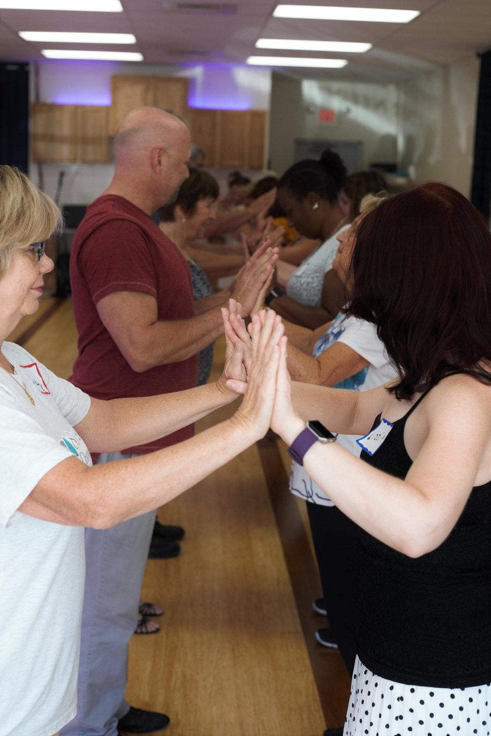 "Dancers learning how to ""connect"" with their partners while dancing the cha cha basic step."