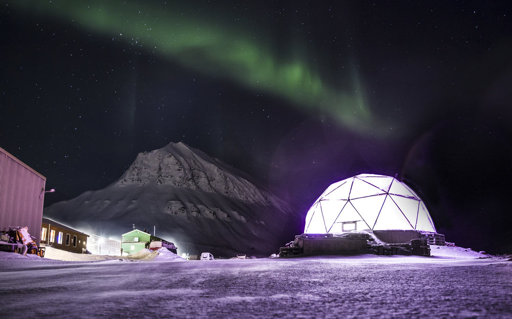 "Northern lights over the ""northern most"" dome greenhouse."