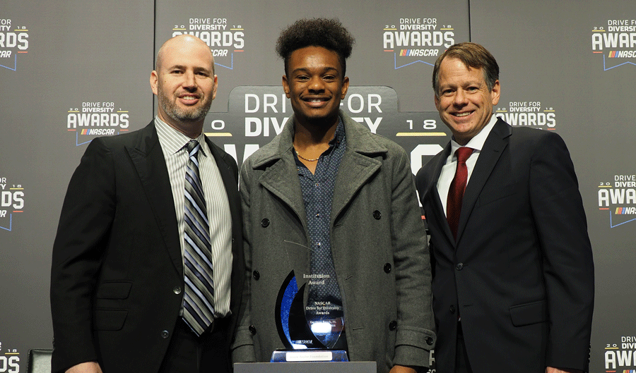 ason Taylor Foundation Executive Director Seth Levit (left), bluapple Poetry Network Youth Engagement Coordinator Marnino Toussaint (middle) and NASCAR   and International Speedway Corporation Chief Sales and Partnership Officer Daryl Wolfe (right) at the 2018 NASCAR Drive for Diversity Awards.