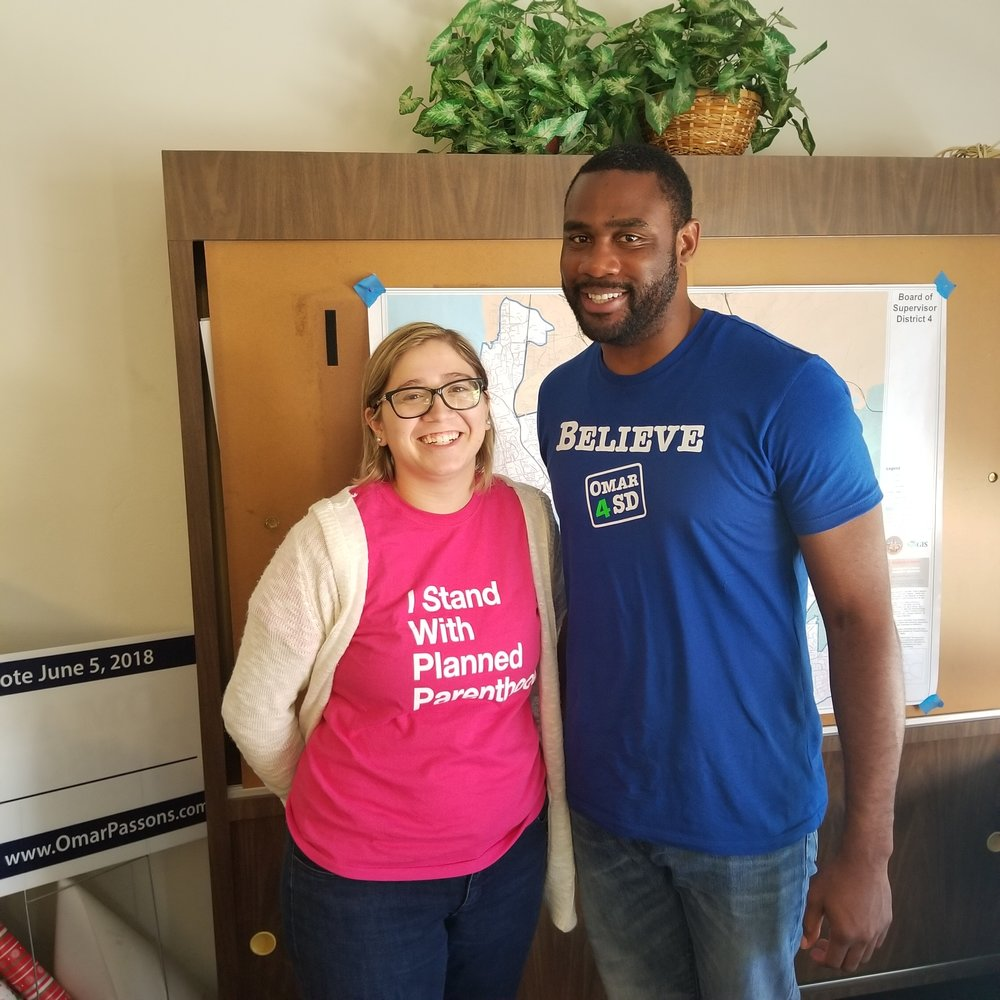 Team Passons staff Melissa Padilla and Rodriquez Wright show their support