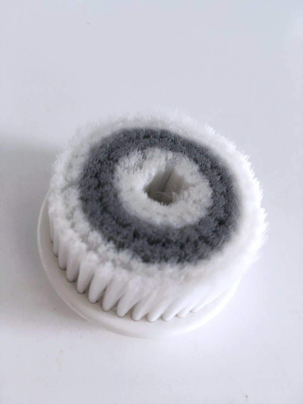 Daily Cleansing Brush - This is the Daily Cleansing Brush. This brush is super soft and is specifically designed to give you the most gentle, tender clean. I use this one in the morning.