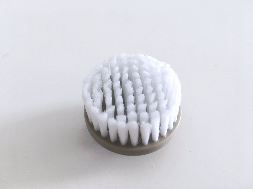 Exfoliating Brush - This is the Exfoliating Brush. Its perfect if you want some extra power to scrub off that dead skin. It has denser packed bristles which make it perfect for the job. I typically use this at night.