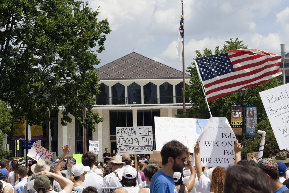 Attendees of the march gather outside the State Legislative Building in downtown Raleigh.