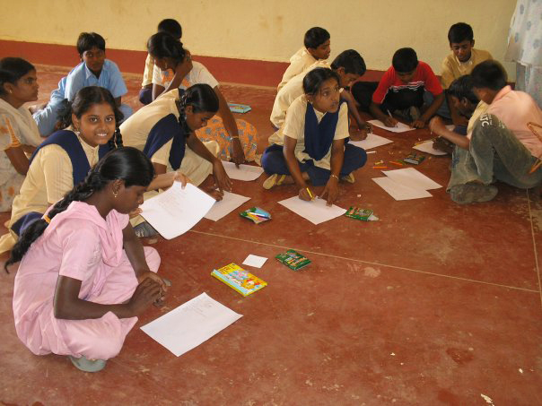 Ninth graders at Bapagrama Educational Center working on their story books. (July 2007)
