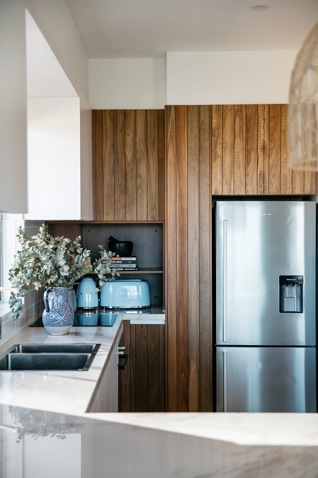 Spotted gum panelled doors in the Bondi kitchen project.