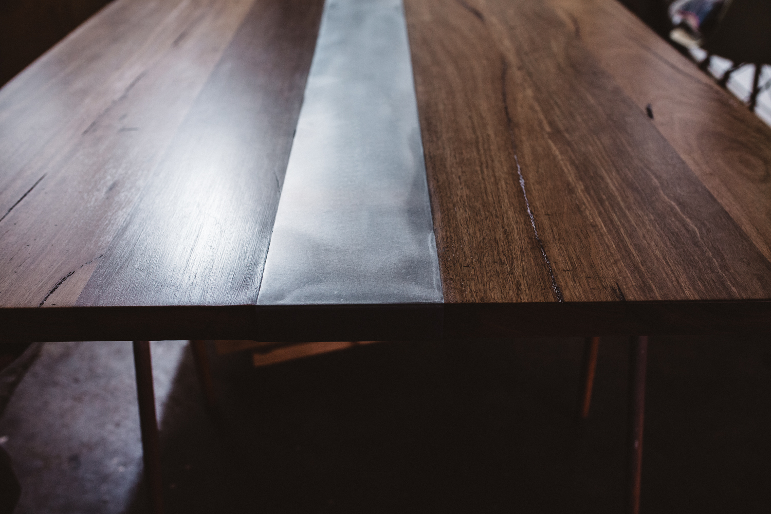 zinc strip in timbermill custom dining table in recycled hardwood.