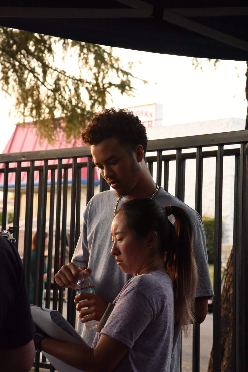 Co-Producer  David Starks  and UPM  Daphne Teng  goes over the shoot day.