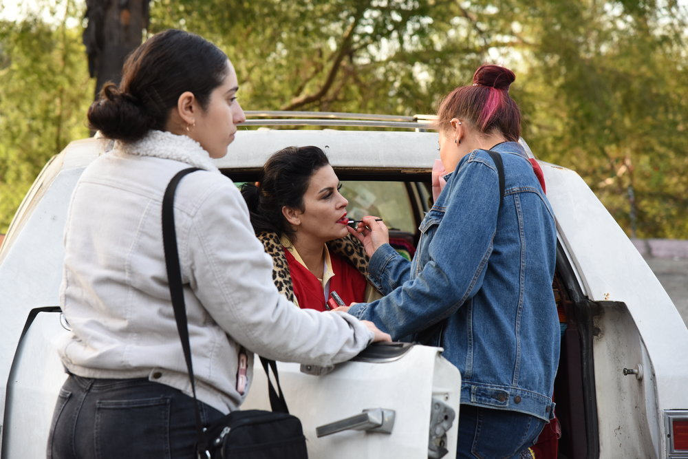 Costumer  Mariam Sabha  and Make-up Artist  Christina Yu  touches up  Raquenel  in between takes.