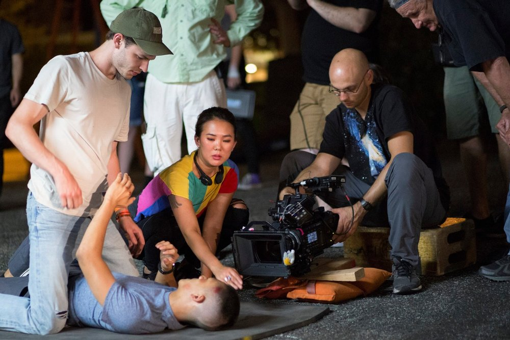 Director  Angela Chen  preps a fight scene with Actors  Nick Fink  and  Brandon Soo Hoo  with B CAM Op  Marcin Banasiak  and Stunt Coordinator  John Branagan .