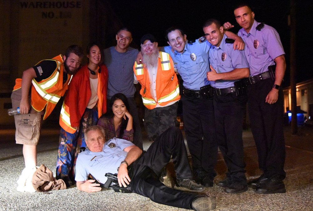 Production Designer  Jake Vollmer , Director  Angela Chen , and Stunt Coordinator  John Branagan  pose with the Actors and Stunt Performers.