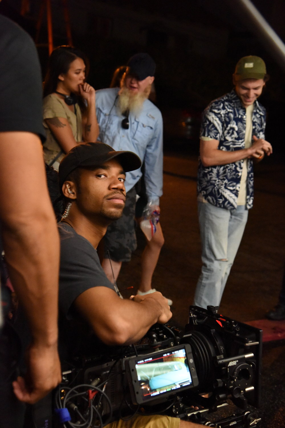 A CAM Operator  Ayinde Anderson  with Actor  Nick Fink  and 1st AD  Will Lambe  and Director  Angela Chen .