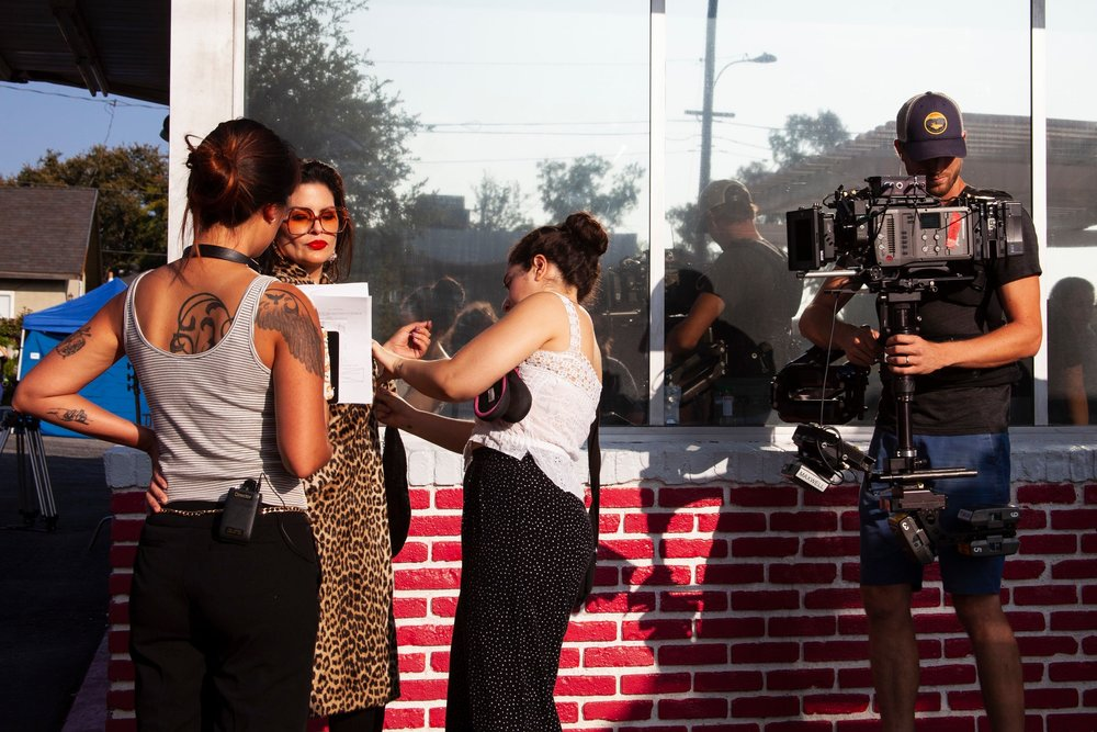 Director  Angela Chen  with Actress  Raquenel  and Costumer  Mariam Sabha  and Steadicam Operator  Brennan Maxwell  preps for the first shot of the day.