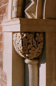 The same area after restoration with newly carved capstone and masonry.