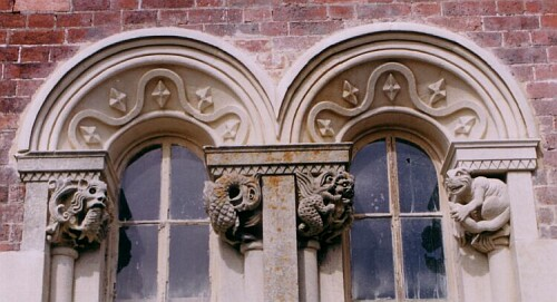 After stone restoration and masonry replaced. Note the newly carved capstone on the right and two new arches with diamond and ribbon detail.