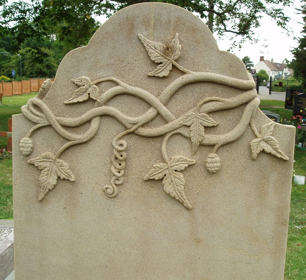 The reverse of a hand carved Yorkstone memorial in London.