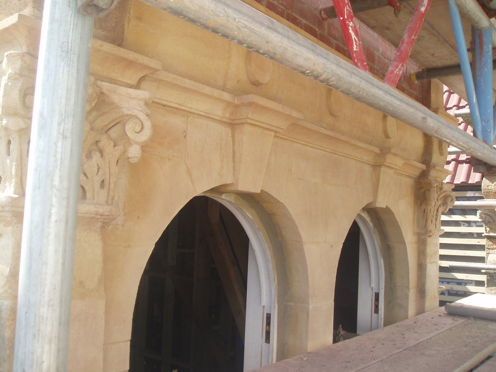 New double window arch made and rebuilt after fire. Capitals were restored using lime mortar repairs techniques.