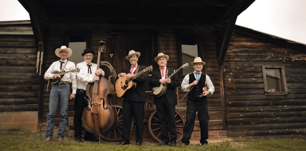 Carnegie Tradition (left to right) :  Ronnie Black (Mandolin/Vocals),   Warren Yates (Bass/Vocals), Wayne Taylor (Lead Vocals/Rhythm Guitar), Donnie Little (Banjo/Vocals),   George Giddens (Fiddle)