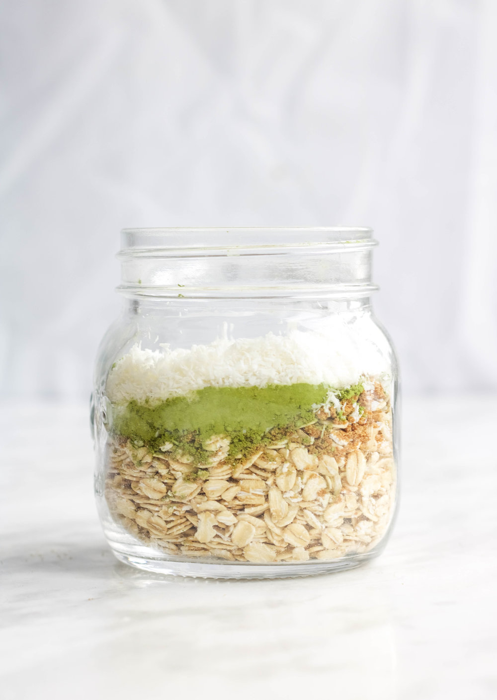 Coconut Matcha Oatmeal  - Ingredients:1 Serving of the base 2 tsp Matcha powder2 heaping tbsp coconut flakes