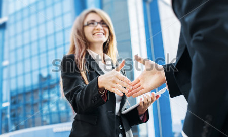 stock-photo-business-partners-shake-hands-standing-in-front-of-his-office-235989346 copy.jpg