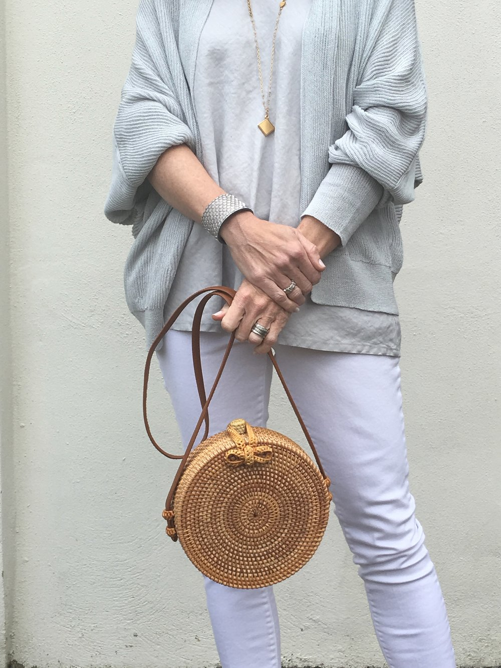 spring cardigan and rattan bag