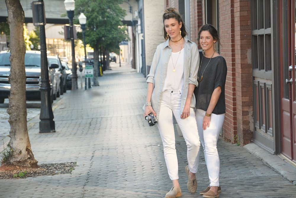 "A stroll with a friend.   MODEL ON LEFT:  Linen Boyfriend Shirt in Dove Gray $92 ,  17"" Choker Necklace $79 ,  Moonstone Necklace with Phelps Slide Pendant $289 ,  Amy Earrings with Moonstone $79 ,  Python Cuff $98   MODEL ON RIGHT:  Cotton Short Sleeve Sweater in Ink $82 ,  Half Moon Labradorite Necklace $189 ,  Half Moon Labradorite Earrings $69 ,  Tallulah $79"