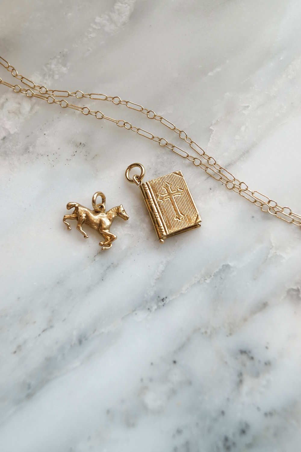 These two 14K gold pendants are available online.  Horse pendant, $195 .  14K Lord's Prayer Locket, $298 .
