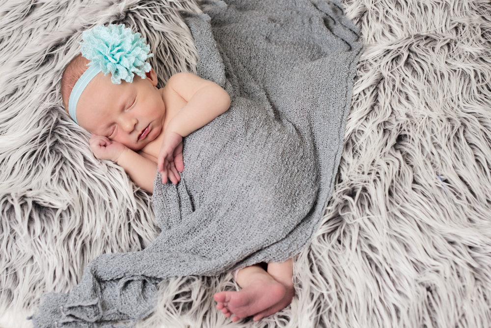 Newborn girl with gray