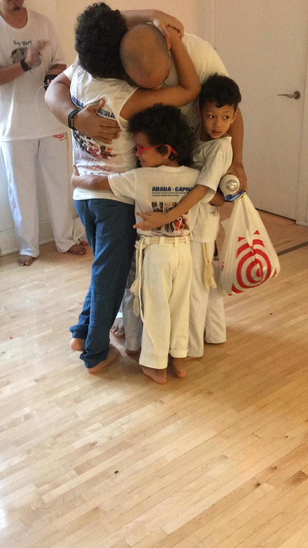 Kids Hug Capoeira Love.JPG