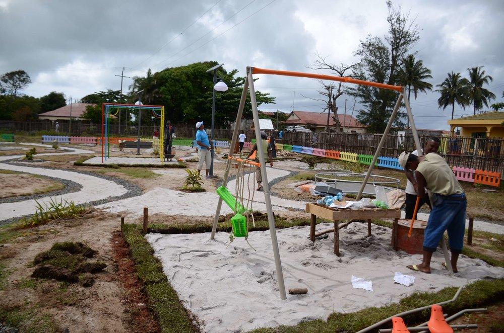 Community members constructing the playground Credit: Lems Andriamihaja/UN-Habitat