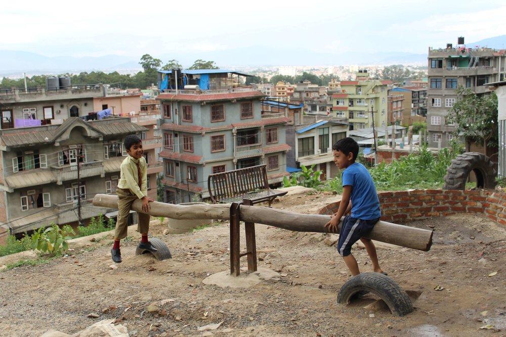 Neighborhood children enjoying the playground, Kirtipur, Nepal Credit: CIUD