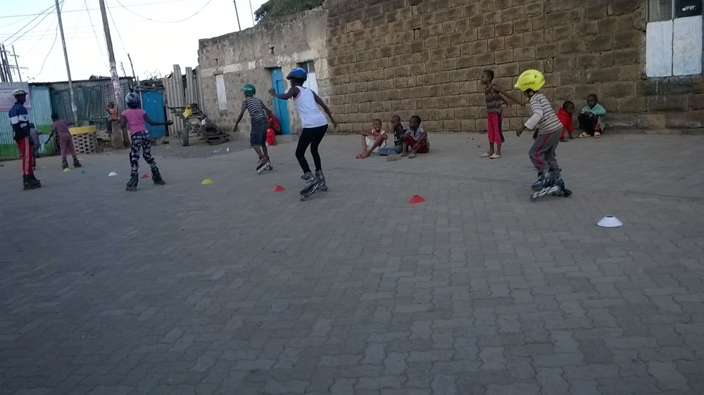 Children rollerblading in renovated street, Dandora, Nairobi Credit: Block by Block team