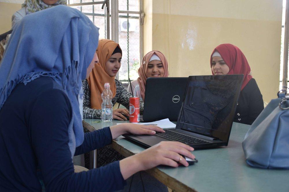 Palestinian teenagers using Minecraft to design public space at a Block by Block Workshop Credit: Pontus Westerberg/UN-Habitat