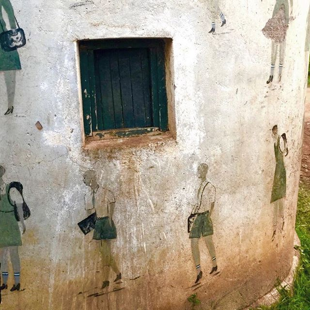This is a gatehouse for a rural elementary school in Nyanza Province, complete with unique hand painted illustrations of school children. #LetGirlsLearn